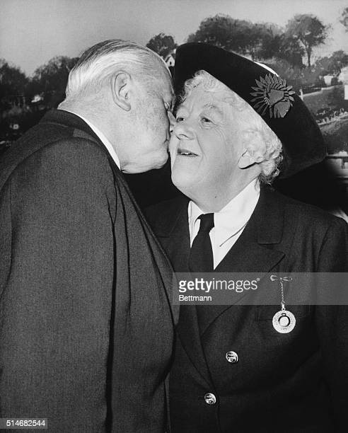 Dame Margaret Rutherford gets a kiss from her husband actor Stringer Davis at Elstree Studios after winning the Academy Award for Best Supporting...