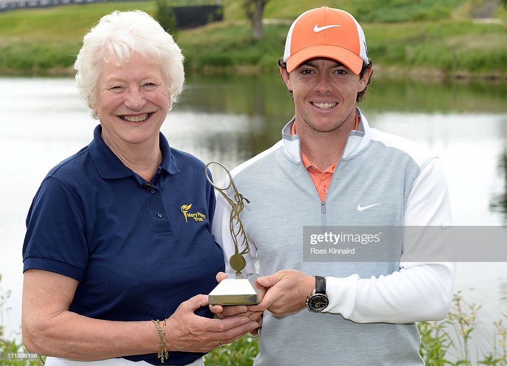 Dame Mary Peters of Northern Ireland presents Rory McIlroy of Northern Ireland with a Worldwide Achievement Award on behalf of the Mary Peters Trust during the pro-am event prior to the Irish Open at Carton House Golf Club on June 26, 2013 in Maynooth, Ireland.