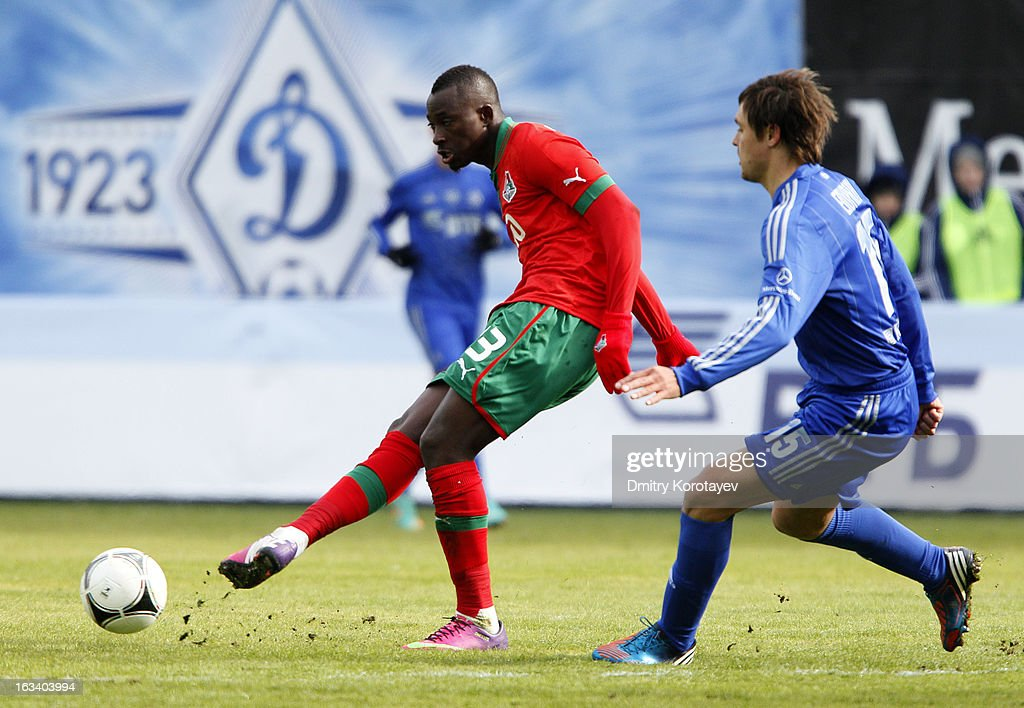 Dame N'Doye (L) of FC Lokomotiv Moscow is challenged by Alexandru Epureanu of FC Dynamo Moscow during the Russian Premier League match between FC Dynamo Moscow and FC Lokomotiv Moscow at the Arena Khimki Stadium on March 09, 2013 in Khimki, Russia.