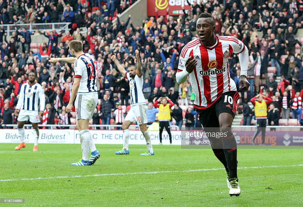 Dame N'Doye of Sunderland celebrates but his late effort is ruled offside during the Barclays Premier League match between Sunderland and West Bromwich Albion at the Stadium of Light on April 02, 2016 in Sunderland, England.