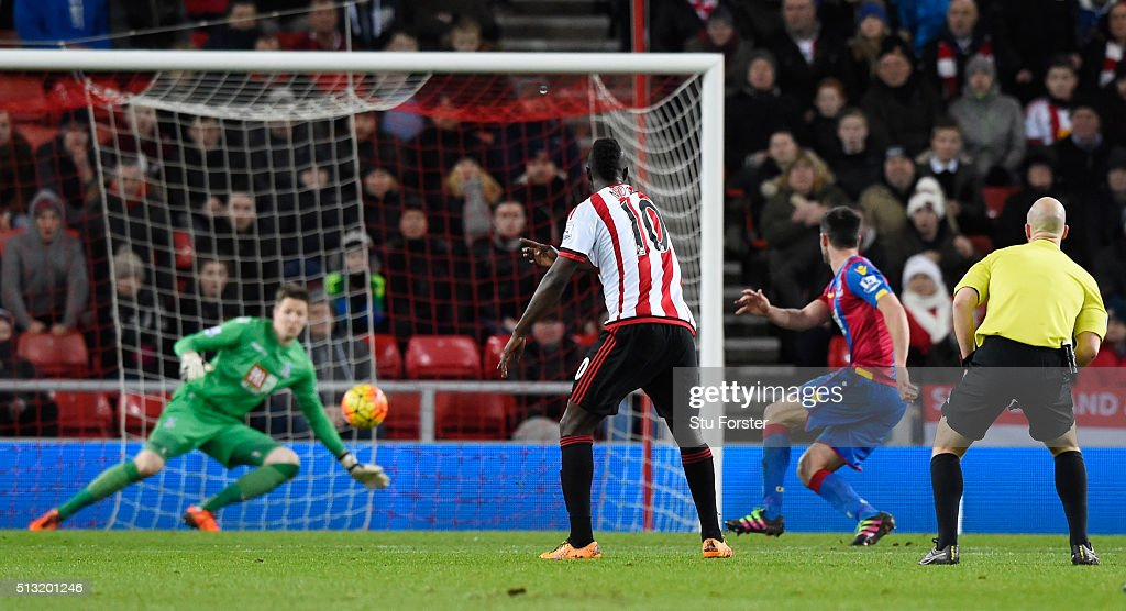 Dame N'Doye (2nd L) of Sunderland scores his team's first goal after his shot deflected by Scott Dann (2nd R) of Crystal Palace during the Barclays Premier League match between Sunderland and Crystal Palace at Stadium of Light on March 1, 2016 in Sunderland, England.