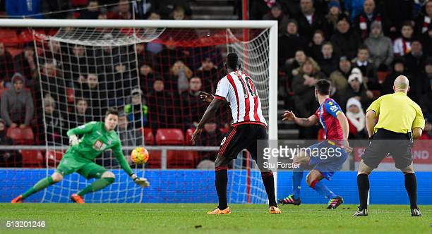 Dame N'Doye of Sunderland scores his team's first goal after his shot deflected by Scott Dann of Crystal Palace during the Barclays Premier League...