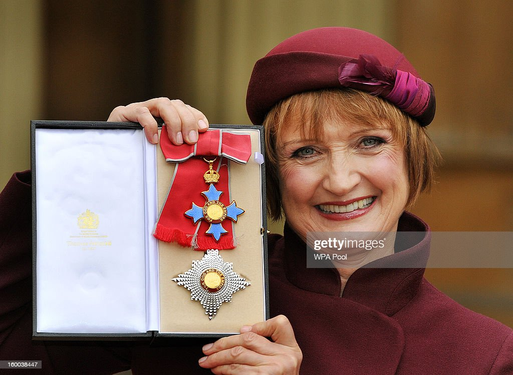 Dame Tessa Jowell proudly holds her Dame Commander insignia, after it was presented to her by the Prince of Wales during the Investiture ceremony at Buckingham Palace on January 25, 2013 in London, England.