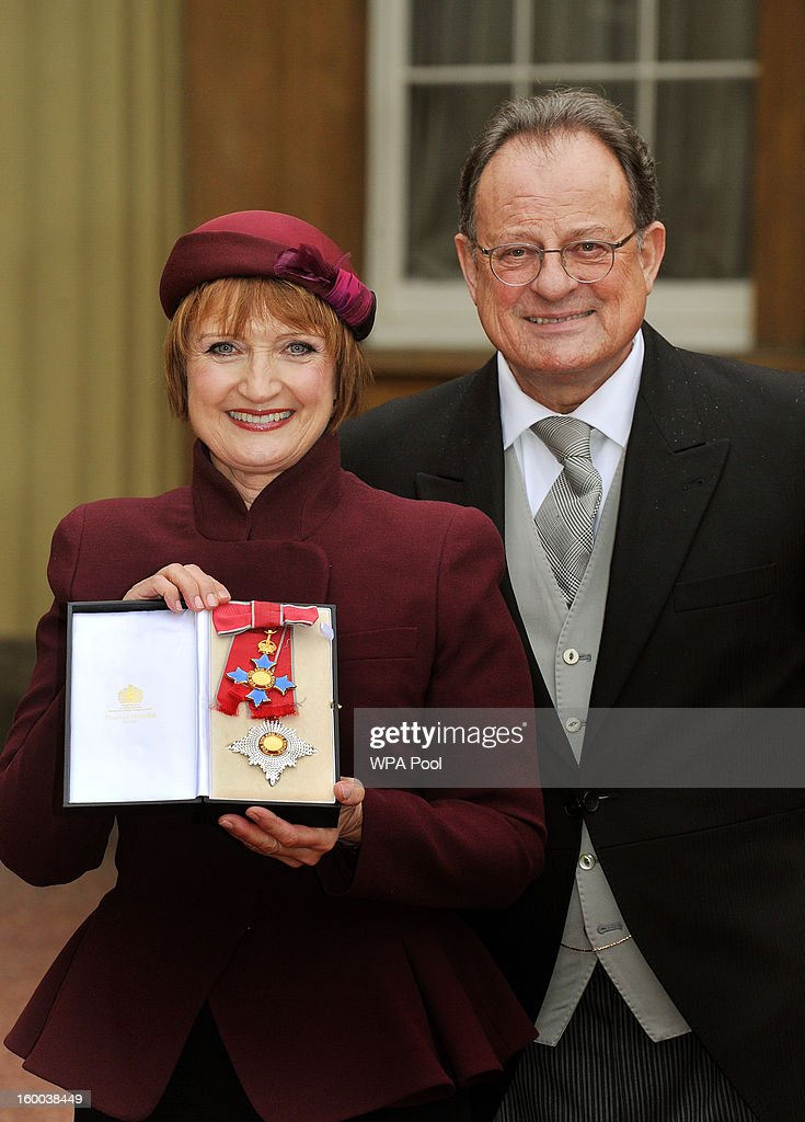 Dame Tessa Jowell with her husband David Mills proudly holds her Dame Commander insignia, after it was presented to her by the Prince of Wales during the Investiture ceremony at Buckingham Palace on January 25, 2013 in London, England.