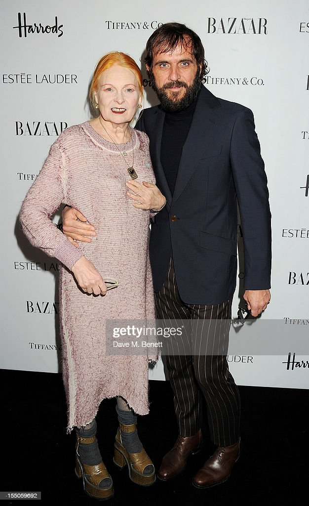 Dame Vivienne Westwood (L) and Andreas Kronthaler attend the Harper's Bazaar Women of the Year Awards 2012, in association with Estee Lauder, Harrods and Tiffany & Co., at Claridge's Hotel on October 31, 2012 in London, England.