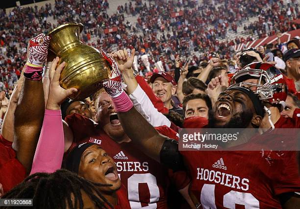 Dameon Willis Jr #43 of the Indiana Hoosiers and members of the Indiana Hoosiers celebrate with fans after the game against the Michigan State...