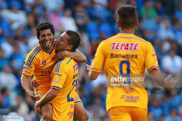 Damian Alvarez of Tigres celebrates with teammates after scoring the first goal of his team during a match between Queretaro and Tigres UANL as part...