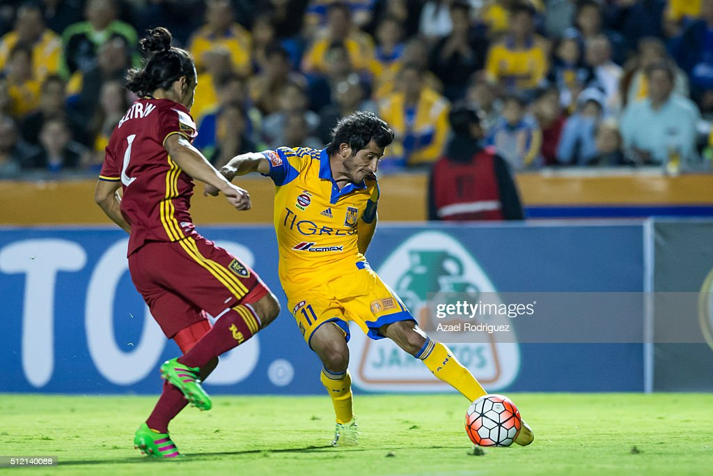 Damian Alvarez of Tigres fights for the ball with Anthony Beltran of Real Salt Lake during a quarterfinals first leg match between Tigres UANL and...