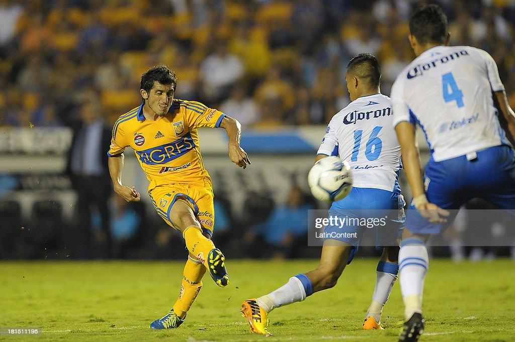 Damian Alvarez of Tigres hits the ball during a match between Tigres UANL and Puebla FC as part of the Liga MX at Universitario stadium on September 21, 2013 in Monterrey, Mexico.