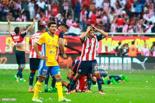 Damian Alvarez of Tigres looks disappointed as Jesús Sánchez of Chivas reacts after winning the Final second leg match between Chivas and Tigres UANL...