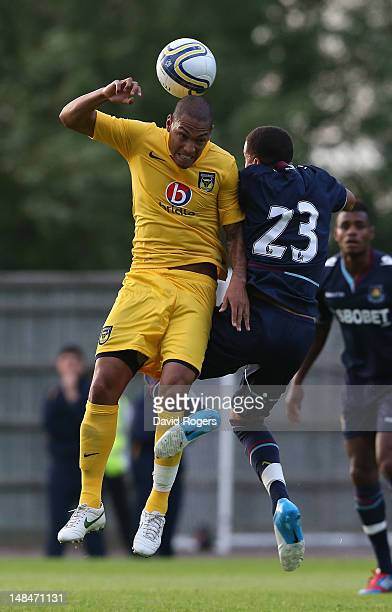 Damian Batt of Oxford United is challenged by Ravel Morrison during the pre season friendly match between Oxford United and West Ham United at Kassam...