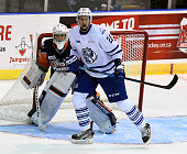 Damian Bourne of the Mississauga Steelheads screens goalie Kyle Keyser of the Flint Firebirds during OHL game action on October 4 2015 at the Hershey...