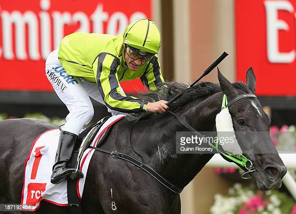 Damian Browne riding Black Cash crosses the line to win race 5 the TCL 4K UHD Smart TV Subzero Challenge during Oaks Day at Flemington Racecourse on...