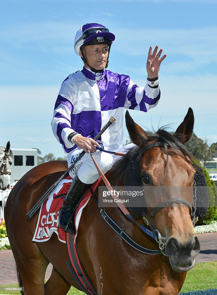 Damian Browne riding Liesele after winning the Carlton Draught Alinghi Stakes during Caulfield Cup day at Caulfield Racecourse on October 19, 2013 in Melbourne, Australia.