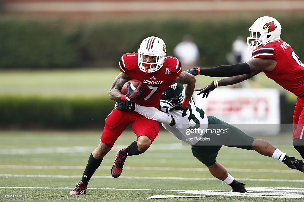 Damian Copeland #7 of the Louisville Cardinals tries to break a tackle after a reception against the Ohio Bobcats during the game at Papa John's Cardinal Stadium on September 1, 2013 in Louisville, Kentucky.