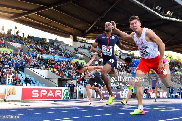 Damian Czykier of Poland and Aurel Manga of France compete in the Men's 110m Hurdles heat 2 during day 1 of the European Athletics Team Championships...