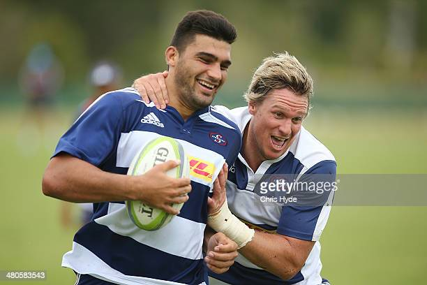 Damian de Allende and Jean de Villiers run the ball during a Stormers Super Rugby training session at Sanctuary Cove on March 26 2014 in Gold Coast...