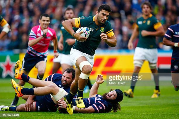 Damian De Allende of South Africa burts through to score their opening try during the 2015 Rugby World Cup Pool B match between South Africa and USA...