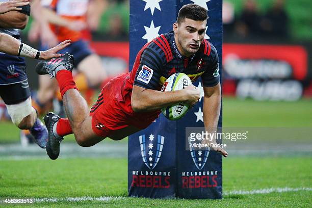 Damian de Allende of the Stormers scores a try during the round 15 Super Rugby match between the Rebels and the Stormers at AAMI Park on July 2 2016...