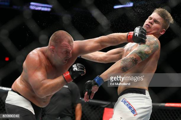 Damian Grabowski lands a left hand on Chase Sherman during their UFC Fight Night heavyweight bout at the Nassau Veterans Memorial Coliseum on July 22...