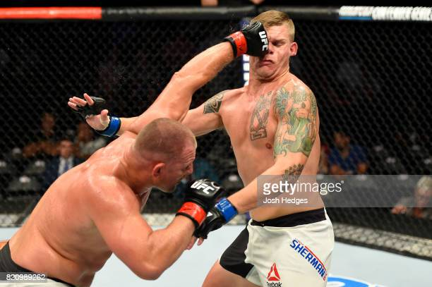 Damian Grabowski of Poland punches Chase Sherman in their heavyweight bout during the UFC Fight Night event inside the Nassau Veterans Memorial...