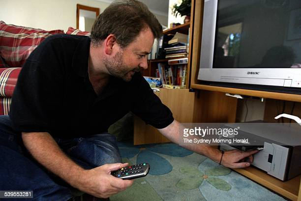 Damian Ivereigh at his home in Drummoyne with the digital recorder which he invented and cannot use due to copyright laws 3 February 2005 SMH Insight...
