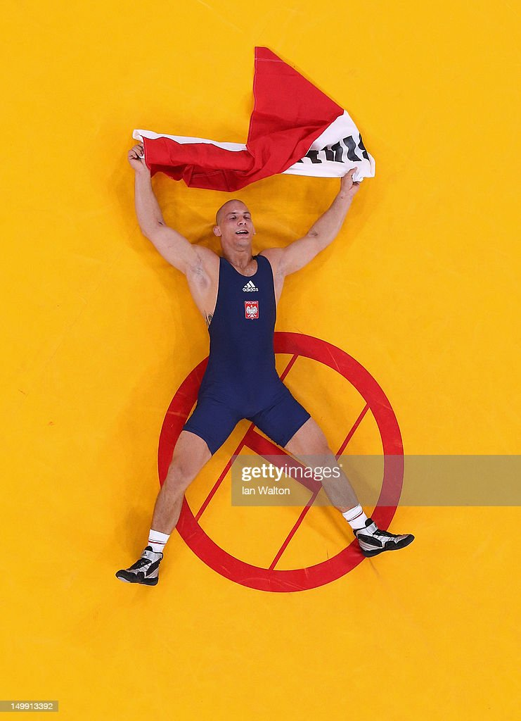 <a gi-track='captionPersonalityLinkClicked' href=/galleries/search?phrase=Damian+Janikowski&family=editorial&specificpeople=8236085 ng-click='$event.stopPropagation()'>Damian Janikowski</a> of Poland celebrates beating Melonin Noumonvi of France in their Men's Greco-Roman 84 kg Bronze Medal bout on Day 10 of the London 2012 Olympic Games at ExCeL on August 6, 2012 in London, England.