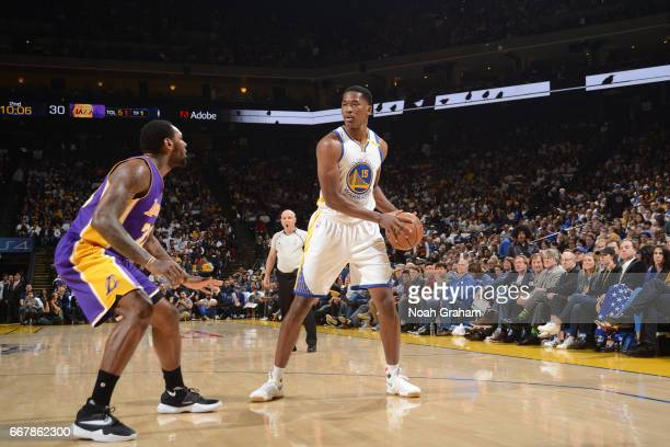 Damian Jones of the Golden State Warriors handles the ball against the Los Angeles Lakers on April 12 2017 at ORACLE Arena in Oakland California NOTE...