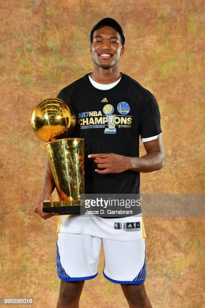 Damian Jones of the Golden State Warriors poses for a portrait with the Larry O'Brien Trophy after defeating the Cleveland Cavaliers in Game Five of...