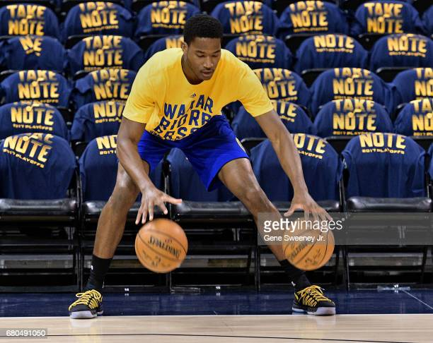 Damian Jones of the Golden State Warriors practices dribbling balls prior to their game against the Utah Jazz in Game Four of the Western Conference...