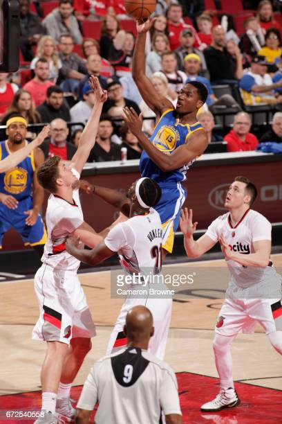 Damian Jones of the Golden State Warriors shoots the ball against the Portland Trail Blazers in Game Four of the Western Conference Quarterfinals of...