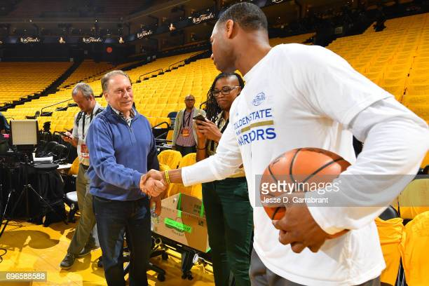 Damian Jones of the Golden State Warriors talks with Michigan State's men's basketball head coach Tom Izzo before Game One of the 2017 NBA Finals...