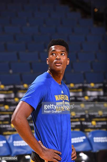 Damian Jones of the Golden State Warriors warms up before the game against the Dallas Mavericks on November 9 2016 at ORACLE Arena in Oakland...