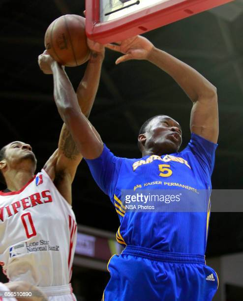 Damian Jones of the Santa Cruz Warriors has his shot blocked by Gary Payton II of the Rio Grande Valley Vipers at the State Farm Arena March 21 2017...