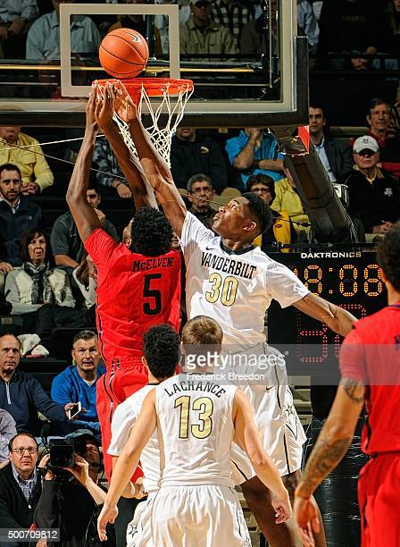 Damian Jones of the Vanderbilt Commodores defends a shot by Steve McElvene of the Dayton Flyers during the first half at Memorial Gym on December 9...