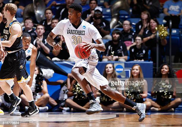 Damian Jones of the Vanderbilt Commodores dribbles the ball in the first half against the Wichita State Shockers during the first round of the 2016...