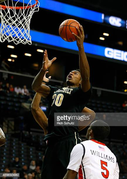 Damian Jones of the Vanderbilt Commodores goes up for a shot in front of Mike Williams of the Rutgers Scarlet Knights during the first half of a game...