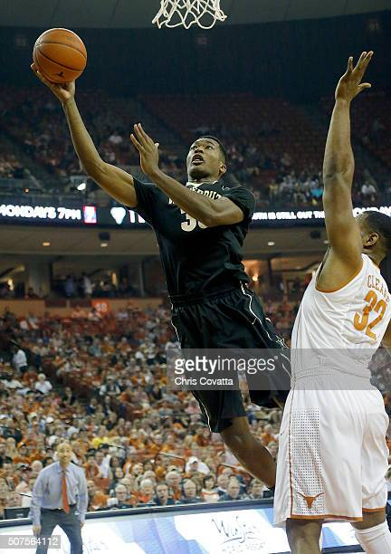 Damian Jones of the Vanderbilt Commodores shoots over Shaquille Cleare of the Texas Longhorns at the Frank Erwin Center on January 30 2016 in Austin...