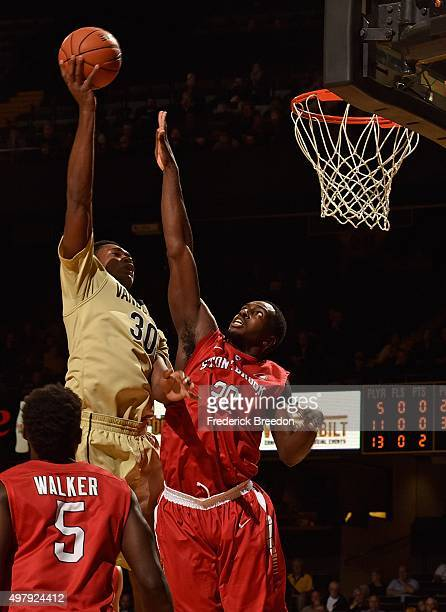 Damian Jones of the Vanderbilt Commodores takes a shot against Jameel Warney of the Stony Brook Seawolves during the first half at Memorial Gym on...