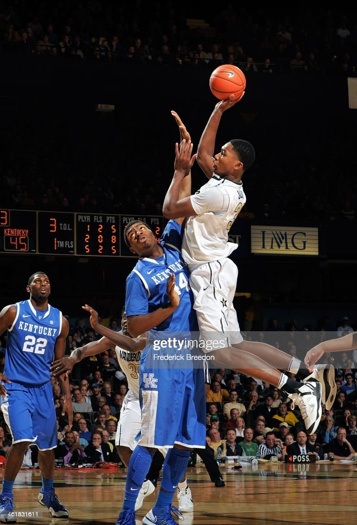 Damian Jones #30 of the Vanderbilt Commodores takes a shot over Dakari Johnson #44 of the Kentucky Wildcats at Memorial Gym on January 11, 2014 in Nashville, Tennessee.