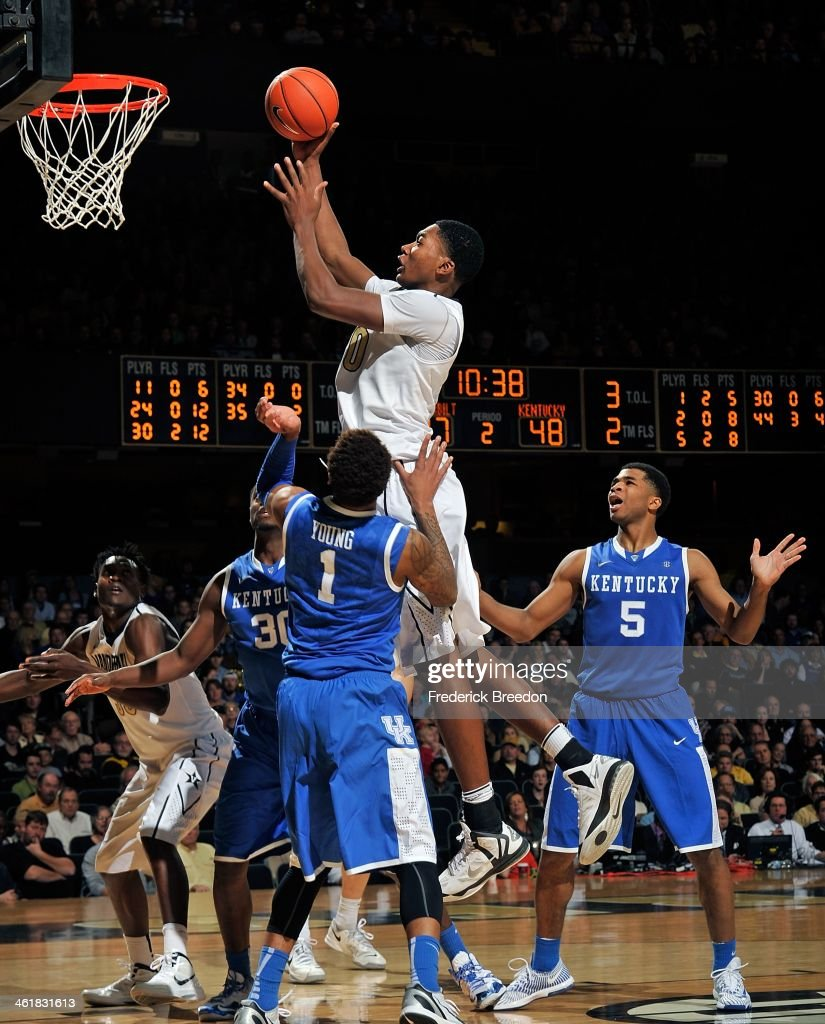 Damian Jones #30 of the Vanderbilt Commodores takes a shot over James Young #1 and Julius Randle #30 of the Kentucky Wildcats at Memorial Gym on January 11, 2014 in Nashville, Tennessee.