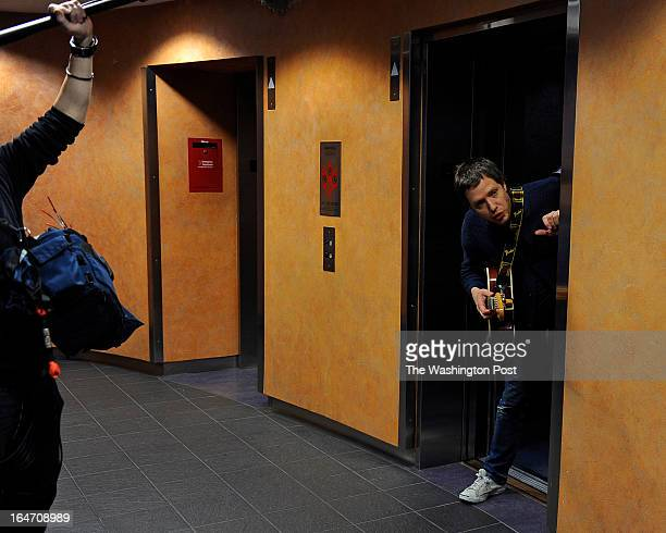 Damian Kulash of the band OK Go peeks out the elevator at the old NPR HQ's as he waits for cue from a video crew during a shoot for a film about the...