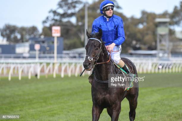Damian Lane returns to the mounting yard on Demolition after winning the IGA Liquor BM70 Handicap at Geelong Racecourse on August 09 2017 in Geelong...