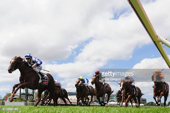 Damian Lane riding Catch a Fire wins Race 3 Angus Armanasco Stakes during Melbourne Racing at Caulfield Racecourse on February 27 2016 in Melbourne...