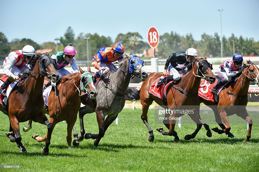 Damian Lane riding Golden Mane (L) wins Race 1, during Melbourne Racing at Caulfield Racecourse on February 6, 2016 in Melbourne, Australia.