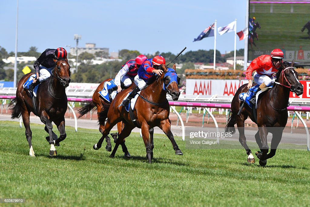 Damian Lane riding Perpetual Crisis (r) wins Race 6 , Inglis Dash during Melbourne Racing at Flemington Racecourse on January 28, 2017 in Melbourne, Australia.