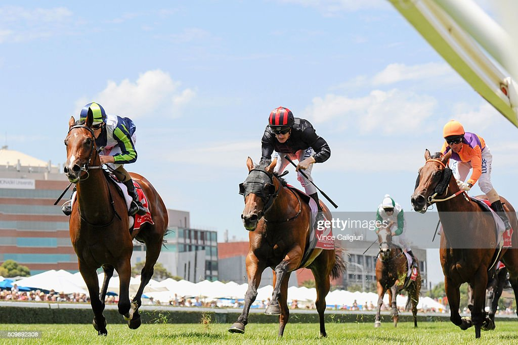 Damian Lane riding Risque (L) wins Race 2, the Kevin Hayes Stakes during Melbourne Racing at Caulfield Racecourse on February 13, 2016 in Melbourne, Australia.