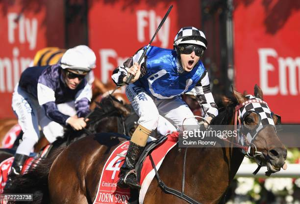 Damian Lane riding Tosen Stardom wins race 8 the Emirates Stakes during 2017 Stakes Day at Flemington Racecourse on November 11 2017 in Melbourne...