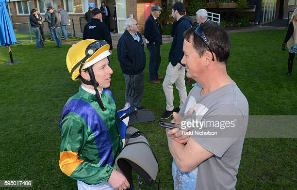 Damian Lane talks to Peter Chow after winning R M Security Services BM70 Handicap at Warrnambool Racecourse on August 25 2016 in Warrnambool Australia