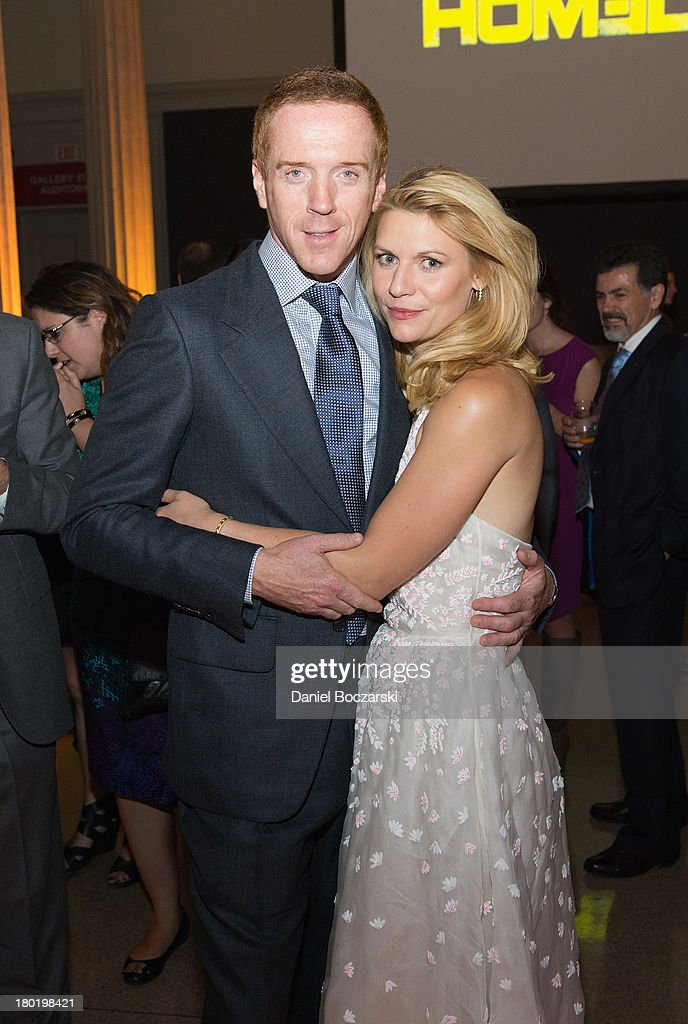 <a gi-track='captionPersonalityLinkClicked' href=/galleries/search?phrase=Damian+Lewis&family=editorial&specificpeople=206939 ng-click='$event.stopPropagation()'>Damian Lewis</a> and <a gi-track='captionPersonalityLinkClicked' href=/galleries/search?phrase=Claire+Danes&family=editorial&specificpeople=202666 ng-click='$event.stopPropagation()'>Claire Danes</a> (R) attend a premiere screening hosted by SHOWTIME and Fox 21 for Season 3 of the hit series 'Homeland' at Corcoran Gallery of Art on September 9, 2013 in Washington City.